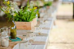 Wine bottle / planter / wooden boxes for centerpieces; burlap for runner.