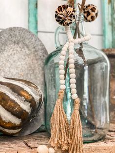 Rustic Boho Inspired Fall Mantel | This fall mantel is not your typical orange pumpkin and bale of hay- instead, we're breaking ALL the rules by using things like leopard print and my fave color…AQUA!! #FallDecor #BoHoStyle #FallMantleInspiration Wood Bead Garland, Leaf Garland, Beaded Garland, Autumn Decorating, Decorating On A Budget, Fall Fireplace, Fall Diy, Autumn Inspiration, Decoration