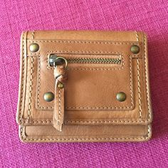 Tan leather Fossil wallet Tan leather Fossil wallet. Opens three ways, pockets for cards and an ID window. Two zippered compartments. Never used. Reasonable offers considered. Fossil Bags Wallets