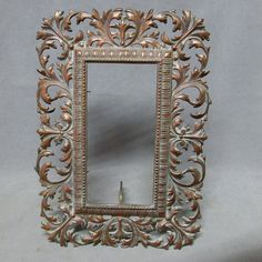 """A very pretty antique Victorian Picture Frame. The frame is made of cast iron with a bronze toned finish and is marked and dated on the back """"Pat'd 8374, July 3, -'94 (1894)"""". Overall dimensions are 14"""" high x 9 3/4"""" wide, the opening when measured from the back is approximately 9"""" x 4 3/4"""". The frame is in very good overall condition with no chips, cracks or repairs. It is complete with it's tabs to hold glass or a mirror, a tin back and it's easel stand. The frame would be lovely with a mirror Victorian Picture Frames, Victorian Pictures, Victorian Dressers, Victorian Era, Framed Leaves, Dresser Sets, Bronze, Antiques, Glass"""