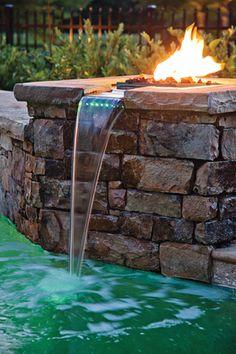 Pool Landscape details like fire bowls, mini waterfalls, and beautiful masonry