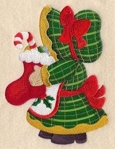 A Sunbonnet Sue Christmas embroidered quilt blocks