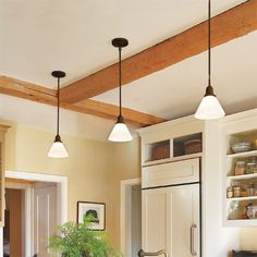 Photo: Olson Photographic/Cornerhouse Stock | thisoldhouse.com | from 28 Thrifty Ways to Customize Your Kitchen  Install mini pendants over an island or a peninsula to bring light down from ceiling height to the work surface.     Similar to shown: Thatcher 1-Light Pendant in iron with frosted glass shade, about $69; Ballard Designs