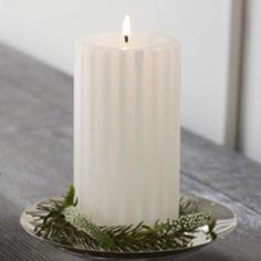 I LOVE PartyLite's carved pillar candles. And this one comes in a favorite fragrance of mine: Iced Snowberries! AND, to top it all off, it's a GloLite, the World's Brightest Candle - glows from top to bottom as soon as you light it!