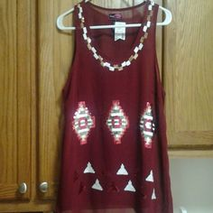 Tank top shirt Brand new with tags the color is a cranberry color new never worn with sequence pattern  and the size is a medium Say What Tops Tank Tops