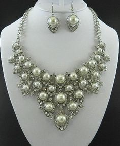 $27  http://yardsellr.com/for_sale/#!/silver-pearl-rhinestones-necklace-and-earring-set-1943301