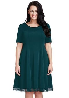 Plus Size Fashion // This elegantly designed skater dress in sold deep green color features a scoop neckline and short sleeves.