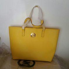 Michael Kors citrus color tote bag * new with tag. * 100% authentic. * good for work or trip. * big enough for folder/laptop. * original price $298. * citrus color, leather. Michael Kors Bags Totes