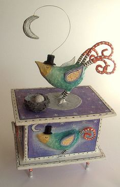 Handmade papier-mache and mixed media box on legs..an exotic bird, tending her nest by moonlight.