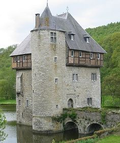 Belgium-Carondelet Castle dates back to the 11th or 12th century. It now stands in a little lake and is connected to its bailey by a stone arched bridge.