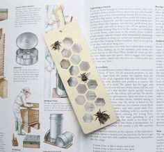 Hey, I found this really awesome Etsy listing at https://www.etsy.com/listing/231687601/honey-bee-silhouette-paper-cut-bookmark