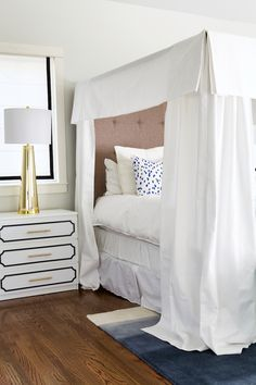 A glam canopy bedroom.