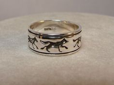 Five Wolves  Sterling Silver Ring  Available by Firefallstudios I really like this!