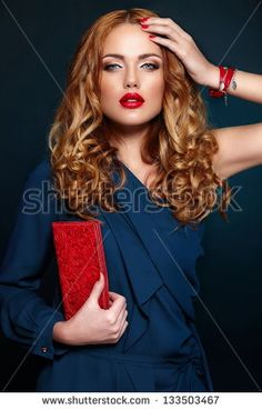 High fashion look.glamor closeup portrait of beautiful sexy stylish blond Caucasian young woman model with bright makeup, with red lips, with perfect clean skin with colorful accessories in blue cloth