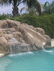 Backyard Pools With Slides awesome for a backyard pool. double waterfall and slide backyard