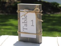 A personal favorite from my Etsy shop https://www.etsy.com/listing/234606505/table-number-holder-photo-holder-wedding