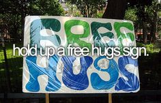 hold up a free hugs sign