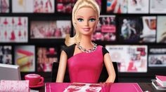 Don't let the pink shift dress fool you. Barbie's latest venture is all business.