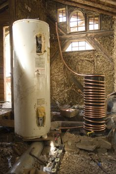 Here is the rocket stove without a barrel and next to the hot water tank.