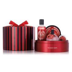 Delight a loved one with a vibrant selection of seasonal bath and body goodies in The Body Shop's Frosted Cranberry Tin of Delights Gift Set. This festive candy-striped tin is brimming with Frosted Cranberry scented treats. Holiday gifts don't get much sweeter! Includes Frosted Cranberry Shower Gel, Frosted Cranberry Body Butter, Frosted Cranberry Shimmer Fragrance Globe, & Frosted Cranberry Lip Balm