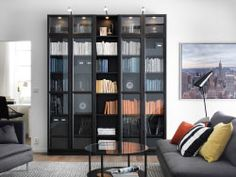A living room with BILLY bookcase in black-brown and SÖDERHAMN sofa in grey