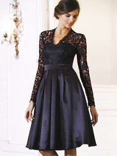 I LOVE the lace on the top of the shoulders and the arms. I think this is very me. The black is very elegant and gives the dress a timeless quality that is irreplaceable. The dresses lower half is soft and silky which reaches to the knee, very sophisticated.