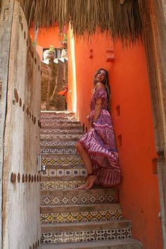 In love with the staircase and orange wall. Would go great in our vacation home in Mexico