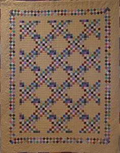 Triple Irish Chain quilt with Seminole border