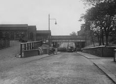 The entrance to Longsight Railway Station on Kirkmanshulme Lane also a 53 Bus