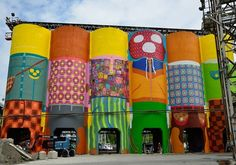 Brazilian twin artists Os Gemeos are always taking it up a notch.. In August, the brothers took on their biggest project to date: an enormous 75-foot-tall, 360-degree mural that measures a total of 23,500 square feet. Envisioned as a non-profit public artwork for the Vancouver Biennale, the piece is intended to leave a lasting mark on the Ocean Cement silos amid the industrial landscape of Vancouver's Granville Island.