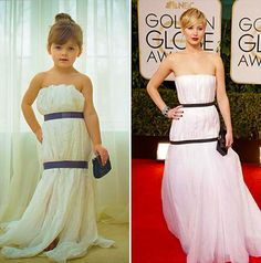 Mayhem, a 4-years-old little girl creates paper dresses. Here, imitating the Jennifer Lawrence's one.