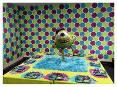 Monsters Party decorations, backdrop, and table setting. The rugs on the table looked just like Sulley's fur and the placemats were inexpensive and easy to make out of construction paper.