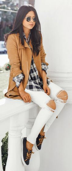 Plaid will never go out of trend! Sheryl Luke wears a simple black and white check shirt with distressed white jeans and a camel suede jacket, a great look for casual outings.  Via Just The Design.   Shirt/Shoes: Sperry, Trench: All Saints, Jeans: RTA.