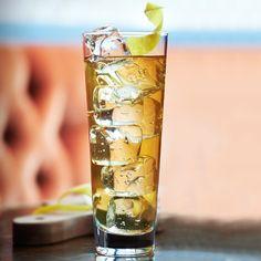Green & Amber 1.5 oz Ultimat Vodka .25 oz Laphroaig Single Malt Scotch Whisky .75 oz Honey syrup (one part honey, one part water) .75 oz Lemon juice 1.5 oz Brewed green tea (Ito En)   Garnish:  1 Lemon twist