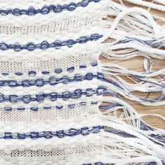 Could be achieved through hand-knitting using eyelets. And threading rope and yarn through.