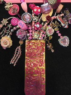 This is a 100 percent handmade recycled jewelry art pink bouquet. First I glue black felt on cardboard backing and then I securely glue the jewelry on the fabric. The jewelry ranges from contemporary to vintage. I use beads, rhinestones, baubles, and charms, from necklaces,