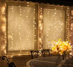 DIY Curtain Lights using LED Mini String Lights - Perfect outdoor lighting idea for a backyard party or diy wedding photo booth backdrop!