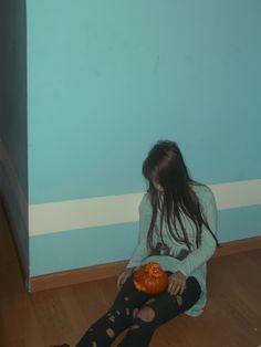 Sitting Mereine and pumpkin
