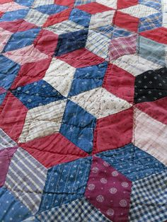 This beautiful quilt is an optical illusion, a star pattern or tumbling blocks, vintage quilt