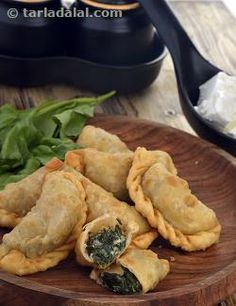Shaped and prepared like ghughras, the Spinach and Cheese Sambousek is a famous Lebanese dish that features a plain flour shell containing a succulent spinach and cheese mixture. We have used crumbled feta cheese as it gives the most authentic flavour and texture to this dish.