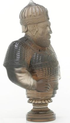 Russian carved smokey quartz desk seal, imperial lapidary works, late 19th century in the form of a portrait bust, depicting a medieval warrior.  Image Sothebys