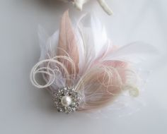 White Ivory and Pink Champagne Feather Hair Clip by SomethingMused, $45.00