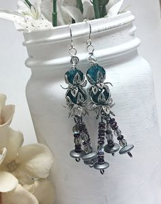 Check out this item in my Etsy shop https://www.etsy.com/listing/247710098/crystal-flower-earrings-modern-flower