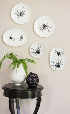Turn old plates into Halloween wall art covered in spiders!
