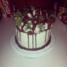 Vanilla pound cake with chocolate dipped strawberries drizzled in chocolate ganach