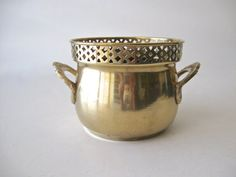 A lovely vintage brass cachepot that can be used in so many ways. It is perfect as an accent piece for any decor, or as a holder for a plant. Decorative handles at each side. Gorgeous detailing on rim.  Measures about 4 high and about 5 wide. Really nice vintage condition. One or two very minor dings.   Thank you for visiting.