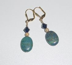 Oval Blue Green Stone with stardust gold bead and Swarovski dark blue crystal wth Gold Plated Leverback Earrings Stones are so pretty with peacock like shades of blue and green.gold plated balls and pins. Just perfect for the office. Just about 1 inches Denim Earrings, Stone Earrings, Drop Earrings, Stone Gold, Green Stone, Dark Blue, Blue Green, Swarovski Pearls, Blue Crystals