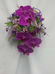 bouquet of Phalaenopsis orchids, succulents, and much more. So different and new!
