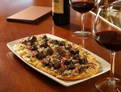 Filet Mignon Flatbread with danish blue and monterey jack cheeses, red onion confit at Flemings Crabtree Valley Mall. #shopcrabtree