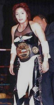 Ayako Hamada wearing the IWRG Intercontinental Women's Wrestling Championship belt